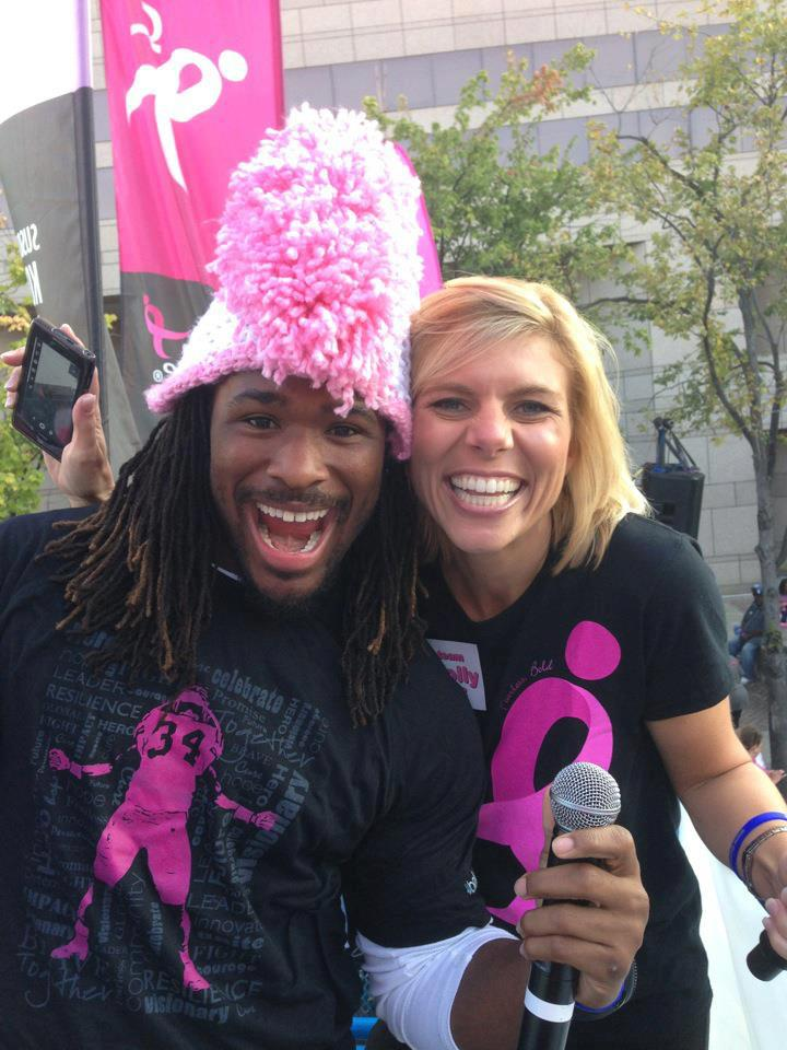 DeAngelo Williams of the Carolina Panthers with WBTV News Anchor Molly Grantham at Komen Charlotte Race for the Cure