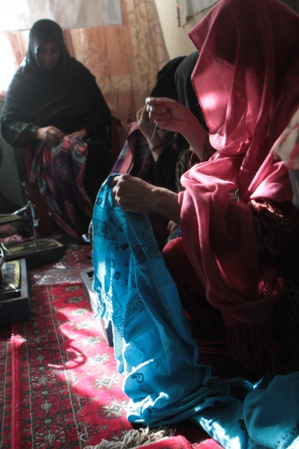 Several Afghan women sew scarves together to be sold through Flying Scarfs, a non-profit organization founded by four aviators while deployed to Bagram Airfield, Afghanistan, in 2011. Since its inception, Flying Scarfs has grossed more than $150,000 in revenue that goes directly back to Afghani women. (Courtesy photo)