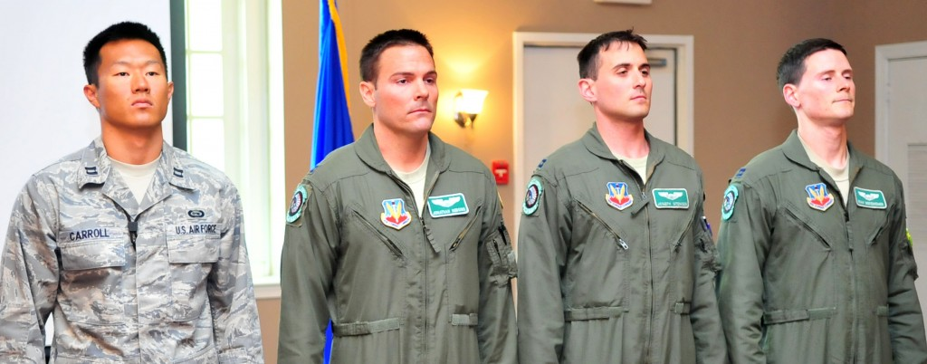 U.S. Air Force Captains Josh Carroll (left), Johnathan Hudgins, Joseph Stenger, and Ryan Bodenheimer wait to receive their Military Outstanding Volunteer Service Medal on Seymour Johnson Air Force Base, N.C., April 18, 2012. While conducting combat operations in support of Operation Enduring Freedom the Airmen dedicated over 700 hours of personal time creating a non-profit organization to help impoverished Afghan women and children. (U.S. Air Force photo/Staff Sgt. Makenzie Lang/Released)