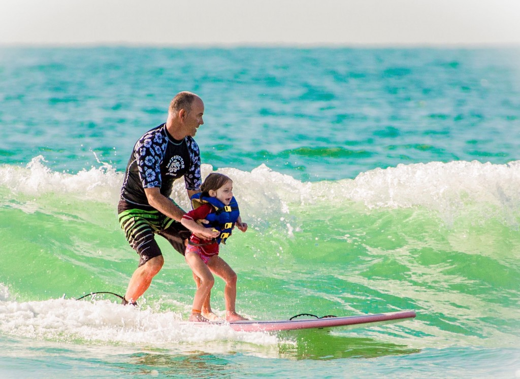 Camper with Jack Viorel, founder of Indo Jax Surf Charities, photo courtesy Jesse Stephenson
